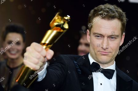 Alexander Fehling holds his award for best supporting actor in the 69th German Film Awards 'LOLA' in Berlin, Germany, 03 May 2019. The most highly endowed cultural award in Germany is presented in 18 categories by the Deutsche Filmakademie (German film academy).
