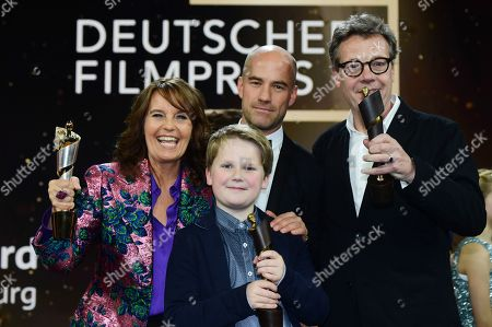 Stock Picture of Caroline Link (L), actor Julius Weckauf (2-L) and other members of the cast of the German film 'Der Junge muss an die frische Luft' pose with their award for the movie with the highest number of visitors, in the 69th German Film Awards 'LOLA' in Berlin, Germany, 03 May 2019. The most highly endowed cultural award in Germany is presented in 18 categories by the Deutsche Filmakademie (German film academy).