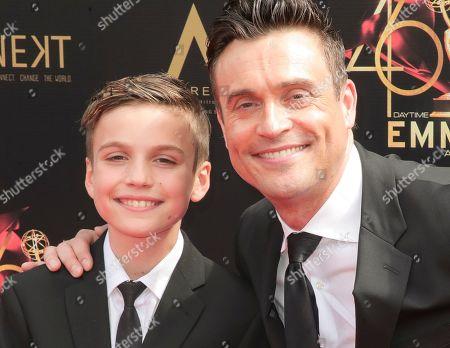 Stock Photo of Daniel Goddard (R) and his son
