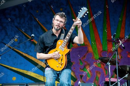 Stock Image of Luther Dickinson of North Mississippi Allstars performs at the New Orleans Jazz and Heritage Festival, in New Orleans