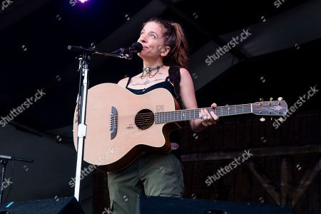 Stock Picture of Ani DiFranco performs at the New Orleans Jazz and Heritage Festival, in New Orleans