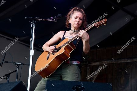Stock Image of Ani DiFranco performs at the New Orleans Jazz and Heritage Festival, in New Orleans