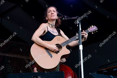 Ani DiFranco performs at the New Orleans Jazz and Heritage Festival, in New Orleans