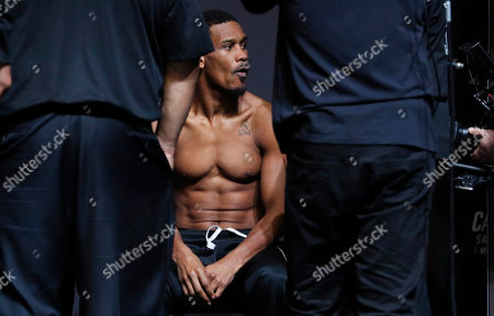 Daniel Jacobs waits before standing on the scale during a weigh-in for a middleweight title boxing match against Canelo Alvarez, in Las Vegas. The two are scheduled to fight Saturday in Las Vegas