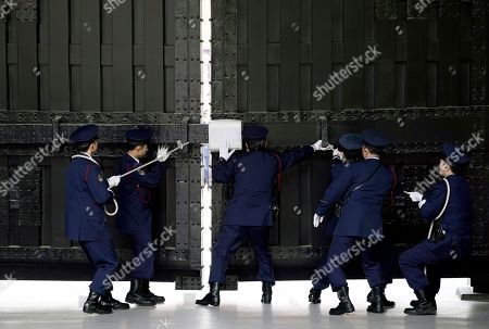 Imperial Palace security personel open the gate from where thousands of well-wishers will enter to greet Emperor Naruhito and Empress Masako during their first public appearance after ascension at the Imperial Palace in Tokyo, Japan, 04 May 2019. On 01 May, Emperor Naruhito succeeded his father Akihito who abdicated on 30 April. On the left is Crown Prince Akishino.