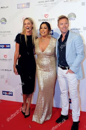 Global Gift Foundation Chairwoman Maria Bravo (C), Irish singer Ronan Keating (R) and his wife Storm Keating (L) pose for the photographers upon their arrival for a charity gala in Marbella, southern Spain, late 03 May 2019 (issued 04 May 2019). Keating and Bravo organized the event to raise funds for the NGOs Global Gift Foundation and Ronan Keating Foundation.