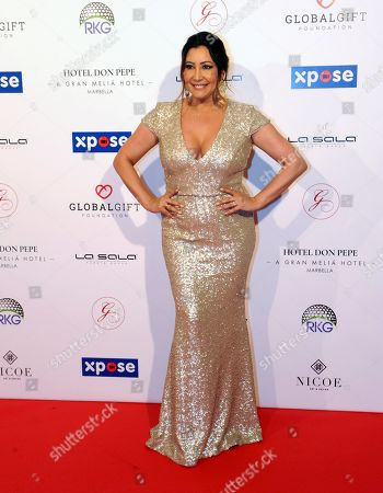 Global Gift Foundation Chairwoman, Maria Bravo poses for the photographers upon their arrival for a charity gala in Marbella, southern Spain, late 03 May 2019 (issued 04 May 2019). Bravo and Irish singer Ronan Keating (unseen) organized the event to raise funds for the NGOs Global Gift Foundation and Ronan Keating Foundation.