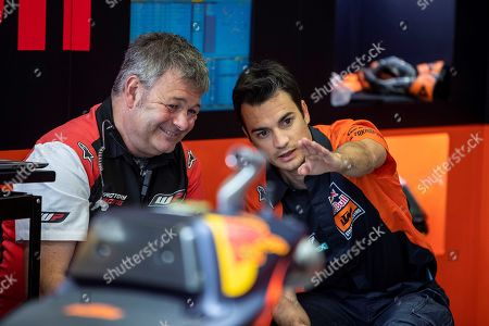 Stock Photo of Former Spanish MotoGP rider Dani Pedrosa (R) chats with a technician the KTM  team garage  during the third free training session for motorcycling Grand Prix of Spain at Circuito de Jerez-Angel Nieto in Jerez, Cadiz, southern Spain, 04 May 2019. The motorcycling Grand Prix of Spain will be held on 05 May.