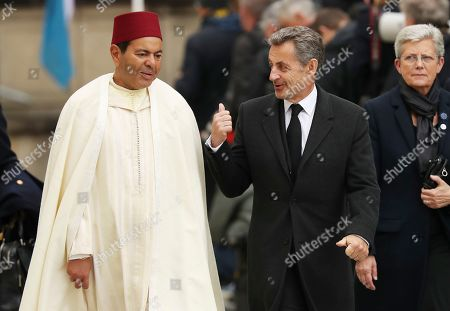 Prince Moulay Rachid of Morocco, left, and former France Prime Minister Nicolas Sarkozy leave the Notre Dame cathedral after attending at the funeral of the Grand Duke Jean of Luxembourg, in Luxembourg
