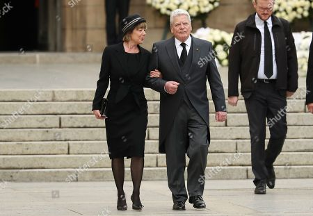 Former German Federal President Joachim Gauck and his wife Daniela Schadt leave the Notre Dame cathedral after attending at the funeral of the Grand Duke Jean of Luxembourg, in Luxembourg