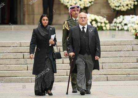 Jordan's Prince El Hassan Bin Talal, right, and his wife Princess Sarvath El Hassan bin Talal leave the Notre Dame cathedral after attending at the funeral of the Grand Duke Jean of Luxembourg, in Luxembourg