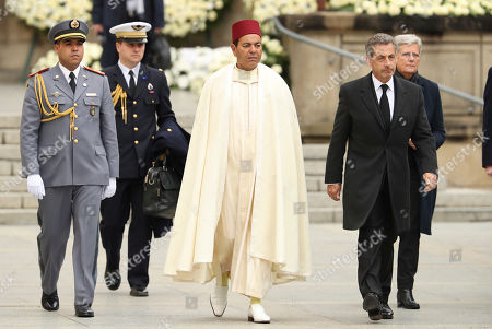 Prince Moulay Rachid of Morocco, center, and former France Prime Minister Nicolas Sarkozy, right, leave the Notre Dame cathedral after attending at the funeral of the Grand Duke Jean of Luxembourg, in Luxembourg