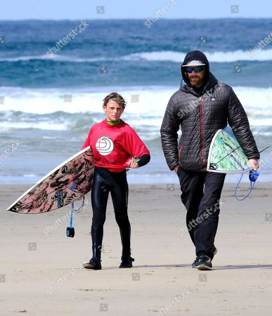Lukes Skinner with his dad Ben Skinner surfing in the U12 Boys Round 1 heat 1 at the Caravan & Motorhome Club English National Surfing Championships.