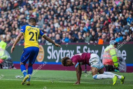 Ryan Bertrand (Southampton) reaches out his arm to Grady Diangana (West Ham) during the Premier League match between West Ham United and Southampton at the London Stadium, London