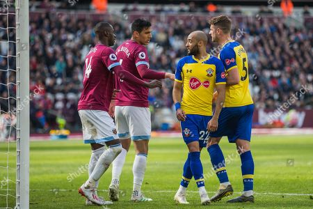 Pedro Obiang (West Ham), Fabian Balbuena (West Ham), Nathan Redmond (Southampton) & Jack Stephens (Southampton) during the Premier League match between West Ham United and Southampton at the London Stadium, London