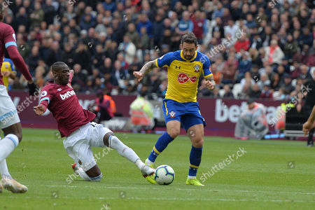 Pedro Obiang of West Ham United tackles Danny Ings of Southampton FC during West Ham United vs Southampton, Premier League Football at The London Stadium on 4th May 2019