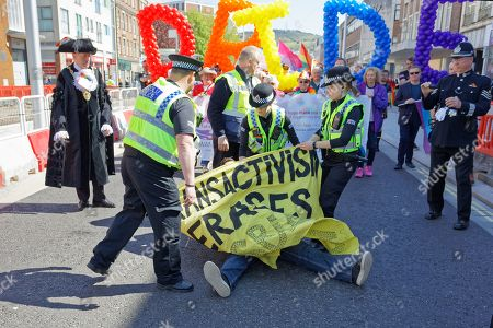 Two anti-lesbian protesters disrupt the parade on the Kingsway infront of The Lord Mayor Councillor David Phillips