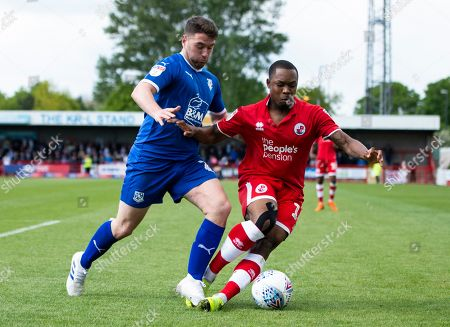 Ashley Nathaniel-George of Crawley Town and Adam Buxton of Tranmere Rovers