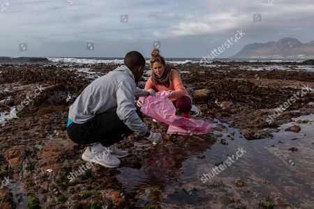 South African students pick up plastic waste and debris during a beach cleanup of the inter-tidal zone of Dalebrook tidal pool in Kalk Bay, Cape Town, South Africa, 04 May 2019. The cleanup was organized by Oceano Reddentes, a South African Non-Profit Organization teaching ocean users to collect plastic to make Ecobricks which are then used to build homes for the homeless. Plastic pollution has reached an epidemic proportion. According to an Ellen MacArthur Foundation report, there will be more plastic in the ocean than fish by 2050. Africa is one of the most affected continents due to its extensive coastline and underdeveloped waste systems allowing plastic waste to easily enter the ocean. The rapid growth of plastic production in the three biggest areas the European Union, China and the US particularly in single-use plastics is recognized as one of the greatest risks facing the environment and mankind. Efforts at recycling and plastic waste education are on the rise on the African continent with many programs being initiated by youth groups who view the problem as the biggest environmental challenge facing the new generation.