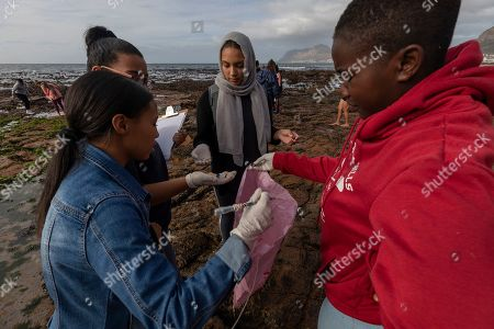 South African students pick up plastic waste and debris during a beach cleanup of the inter-tidal zone of Dalebrook tidal pool in Kalk Bay, Cape Town, South Africa, 04 May 2019.The cleanup was organized by Oceano Reddentes, a South African Non-Profit Organization teaching ocean users to collect plastic to make Ecobricks which are then used to build homes for the homeless. Plastic pollution has reached an epidemic proportion. According to an Ellen MacArthur Foundation report, there will be more plastic in the ocean than fish by 2050. Africa is one of the most affected continents due to its extensive coastline and underdeveloped waste systems allowing plastic waste to easily enter the ocean. The rapid growth of plastic production in the three biggest areas the European Union, China and the US particularly in single-use plastics is recognized as one of the greatest risks facing the environment and mankind. Efforts at recycling and plastic waste education are on the rise on the African continent with many programs being initiated by youth groups who view the problem as the biggest environmental challenge facing the new generation.
