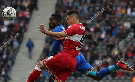 Berlin's Salomon Kalou (L) and Stuttgart's Marc Oliver Kempf in action during the German Bundesliga soccer match between Hertha BSC and VfB Stuttgart in Berlin, Germany, 04 May 2019.