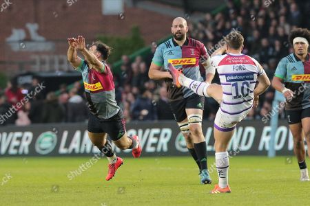 Danny Care of Harlequins goes to charge down George Ford of Leicester