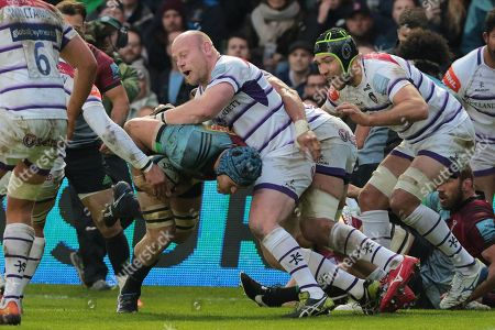 Dan Cole of Leicester tackles James Horwill of Harlequins