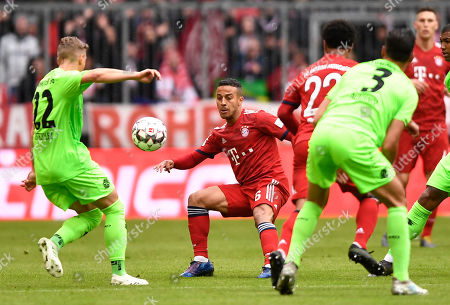 Stock Picture of Bayern's Thiago (C) and Hannover's Matthias Ostrzolek (L) vie for the ball during the German Bundesliga soccer match between Bayern Munich and Hannover 96 in Munich, Germany, 04 May 2019.