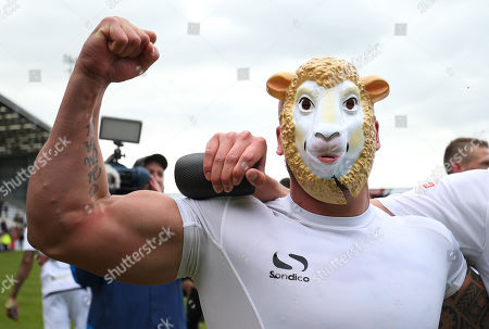 David Pipe of Newport County celebrates behind the sheep mask after taking the final Division 2 Play Off place