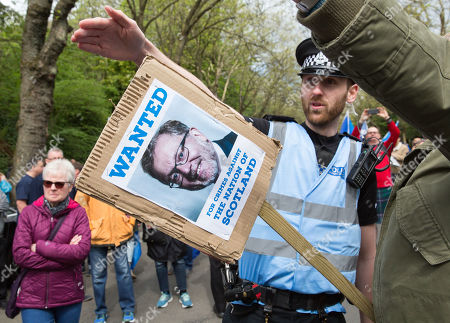 A placard with a picture of British Secretary of State for Scotland, David Mundell is carried as they attend the All Under One Banner (AUOB) march through Glasgow, Scotland, Britain, 04 May 2019. Thousands of campaigners for Scottish independence are holding marches through Glasgow.
