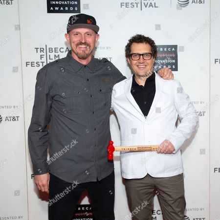Mick Ebeling, Daniel Belquer. Honorees Mick Ebeling, left, and Daniel Belquer attend the 10th annual Tribeca Disruptive Innovation Awards at the Stella Artois Theater, in New York