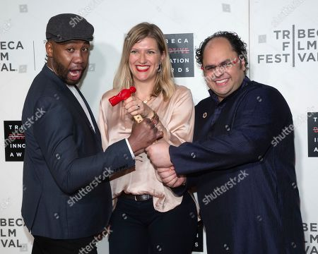 Stock Image of Ndaba Mandela, Beatrice Fihn, Kunal Sood. Ndaba Mandela, from left, presenter Beatrice Fihn and honoree Kunal Sood attend the 10th annual Tribeca Disruptive Innovation Awards at the Stella Artois Theater, in New York