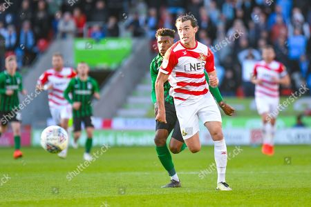 John Marquis of Doncaster Rovers (9) and Dujon Sterling of Coventry City (17) in action during the EFL Sky Bet League 1 match between Doncaster Rovers and Coventry City at the Keepmoat Stadium, Doncaster