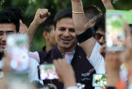 Indian actor Vivek Oberoi (C) gestures as he takes part in a support march for the Delhi Bharatiya Janata Party (BJP) candidates during election campaigning of BJP in New Delhi, India, 04 May 2019. Oberoi plays Indian PM Modi in controversion biopic on Modi and since turned a star campaigner for the BJP in the parliamentary elections. Elections for the Lok Sabha began on 11 April 2019 and are conducted in seven phases throughout India. Results are expected to be announced on 23 May.