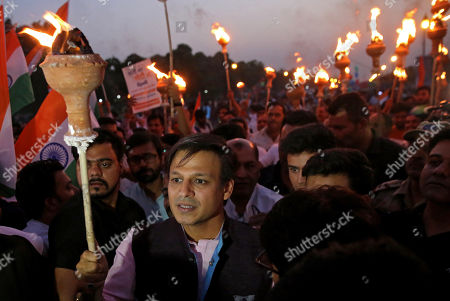Indian actor Vivek Oberoi (C) holds a torch as he takes part in a support march for the Delhi Bharatiya Janata Party (BJP) candidates during election campaigning of BJP in New Delhi, India, 04 May 2019. Oberoi plays Indian PM Modi in controversion biopic on Modi and since turned a star campaigner for the BJP in the parliamentary elections. Elections for the Lok Sabha began on 11 April 2019 and are conducted in seven phases throughout India. Results are expected to be announced on 23 May.