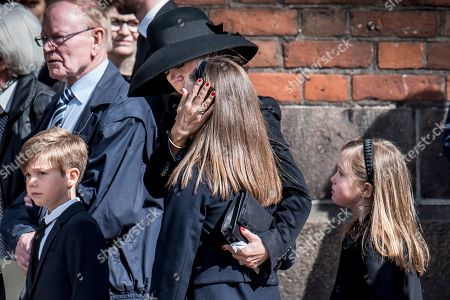 Stock Image of Denmark's Crown Princess Mary (C) and her children Princess Isabella (C), Prince Vincent (L), and Princess Josephine (R) attend a funeral service for the three children of Anders Holch Povlsen and his wife Anne at Aarhus Catherdral in Aarhus, Denmark, 04 May 2019. Three of the four children of Denmark's richest man, billionaire Anders Holch Povlsen were among the victims of the 21 April terror attacks at churches and hotels in Sri Lanka.