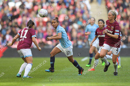 Stock Picture of Claire Rafferty of West Ham United Women and Nikita Parris of Manchester City Women