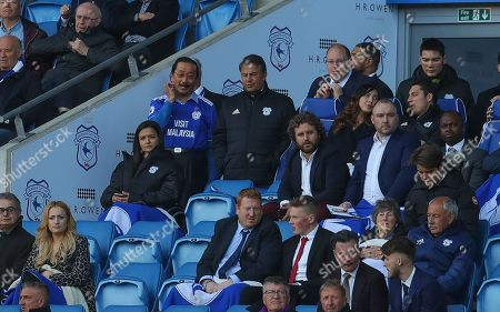 Cardiff City owner Vincent Tan and chairman Mehmet Dalman look on