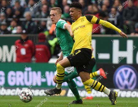 Dortmund's Jadon Sancho (R) in action against Bremen's Ludwig Augustinsson (L) during the German Bundesliga soccer match between SV Werder Bremen and Borussia Dortmund in Bremen, Germany, 04 May 2019.