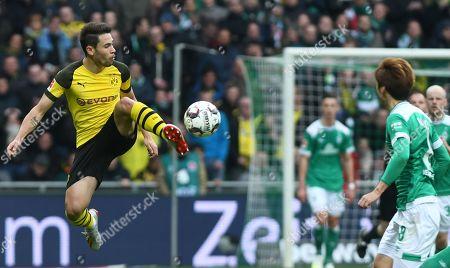 Dortmund's Raphael Guerreiro (L) in action against Bremen´s Yuya Osako (R) during the German Bundesliga soccer match between SV Werder Bremen and Borussia Dortmund in Bremen, Germany, 04 May 2019.