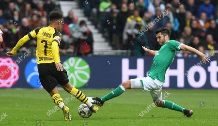 Dortmund's Jadon Sancho (L) in action against Bremen´s Nuri Sahin (R) during the German Bundesliga soccer match between SV Werder Bremen and Borussia Dortmund in Bremen, Germany, 04 May 2019.