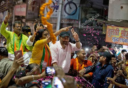 Bollywood actor and India's ruling Bharatiya Janata Party (BJP) candidate Sunny Deol, top right, displays the victory symbol during an election campaign rally for party colleague Rita Bahuguna Joshi in Prayagraj, India