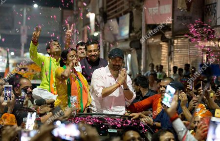 Bollywood actor and India's ruling Bharatiya Janata Party (BJP) candidate Sunny Deol, top right, greets the crowd during an election campaign rally for party colleague Rita Bahuguna Joshi, top left, in Prayagraj, India