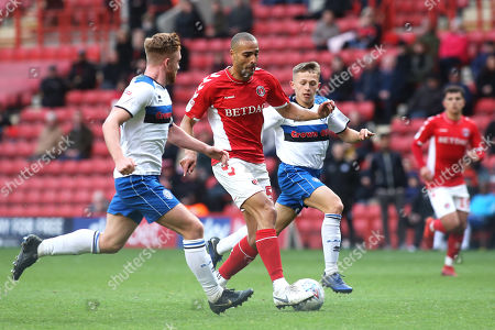 Charlton's Darren Pratley bursts through the Rochdale defence as Lewis Bradley looks on during Charlton Athletic vs Rochdale, Sky Bet EFL League 1 Football at The Valley on 4th May 2019