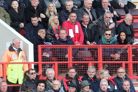 Former Charlton Athletic Manager, Alan Curbishley, (sitting below the two Charlton supporters wearing  scarves) watches the match from the stand during Charlton Athletic vs Rochdale, Sky Bet EFL League 1 Football at The Valley on 4th May 2019
