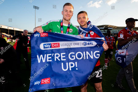 Stock Image of Jack Walton of Barnsley and Jordan Williams of Barnsley celebrates after the final whistle of the match after Barnsley secure automatic promotion to the Sky Bet Championship