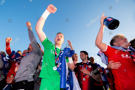 Jack Walton of Barnsley celebrates after the final whistle of the match after Barnsley secure automatic promotion to the Sky Bet Championship