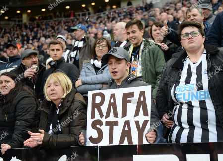 A Newcastle United fan holds up a placard hoping that Rafa Benitez manager of Newcastle United will stay after his contract is up in the summer