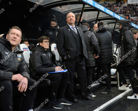 Rafa Benitez manager of Newcastle United and his back room staff watch a giant flag being unfurled at the Gallowgate End at St. James? Park