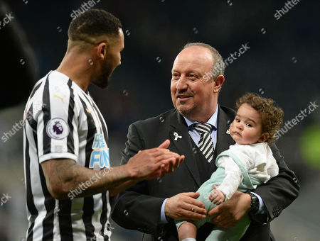 Rafa Benitez manager of Newcastle United holds Jamaal Lascelles of Newcastle United baby as they go on a lap of appreciation to thank their fans for their support throughout the season